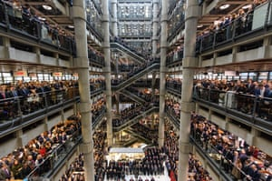 London, UK Workers and guests mark the two-minute silence for Armistice Day in the Lloyd's building