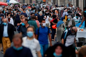 People wearing protective face masks stroll through a flea market in Paris centre on 19 September, 2020.