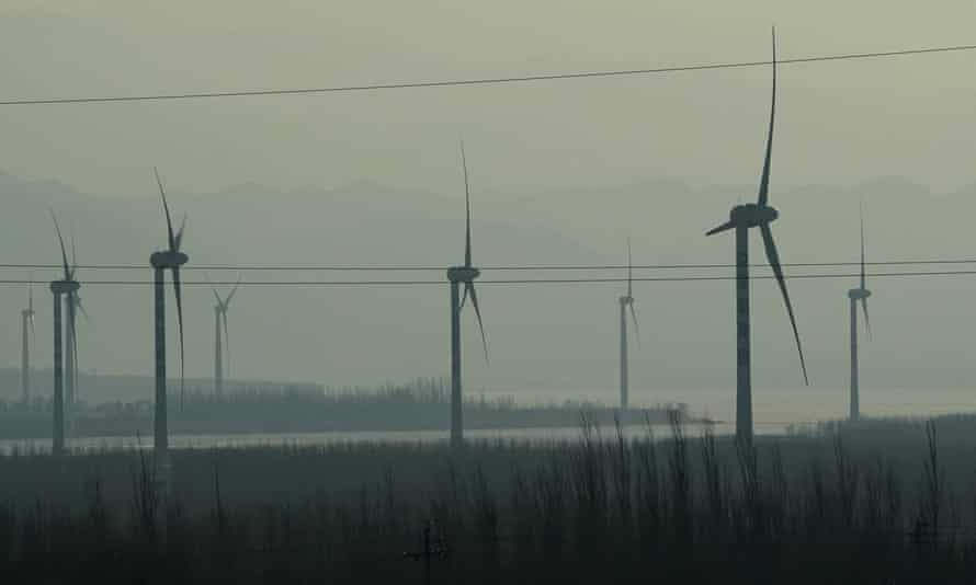 Windmills are seen from a high-speed train travelling from Beijing to China's north-western Hebei province.