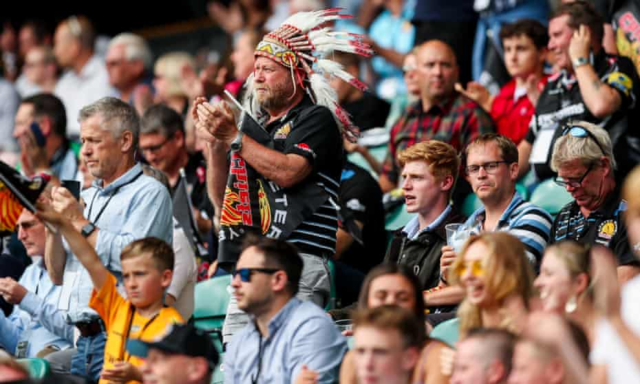 Some Exeter supporters wear Native American headdresses.