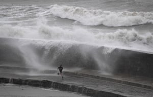 Waves crash over The Cobb in Lyme Regis
