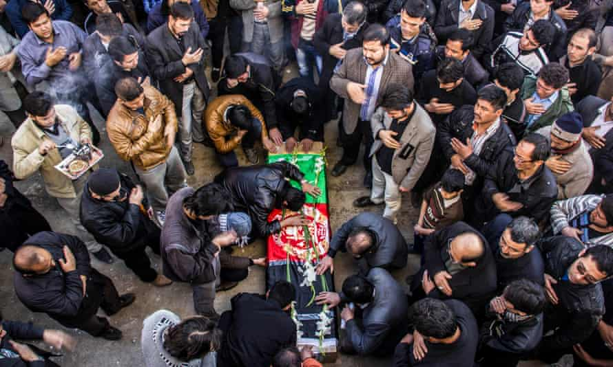 Crowds at a funeral ceremony held in Mashhad for an Iran-based Afghan killed in Syria