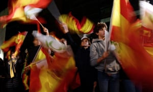 Vox party supporters celebrate outside the party's headquarters during the election night in Madrid