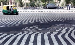Road markings appear distorted during a heatwave in New Delhi, India, May 2015.