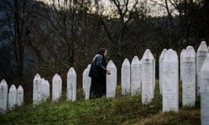 A Bosnian woman offers prayers at the Potocari memorial near Srebrenica.