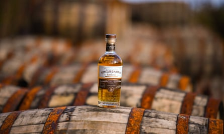 A bottle of Kingsbarn whisky on display on top of bourbon barrels at the distillery and visitor centre in St Andrews, Scotland.