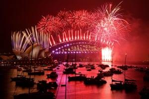 The midnight fireworks erupt over Sydney Harbour Bridge