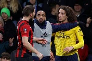 Arsenal's Alexandre Lacazette separates Matteo Guendouzi and Bournemouth's Dan Gosling.