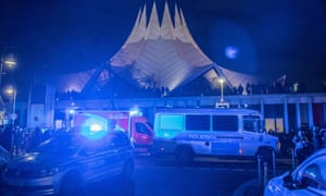 Police and emergency vehicles are seen outside Tempodrom after a shooting