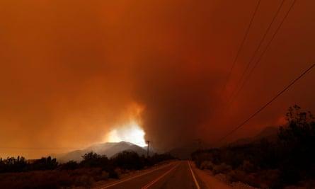 Red smoke covers the sky as the Bobcat Fire burns near Juniper Hills, California, US.