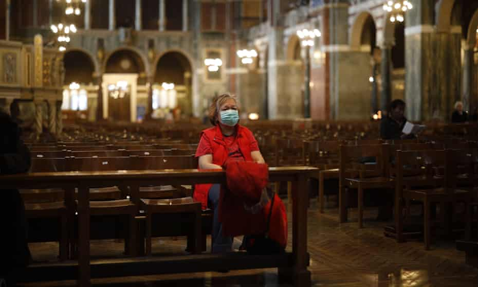 A worshipper sits in Westminster Cathedral in central London on 17 March 2020.