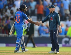 Eoin Morgan congratulates Rohit Sharma after the batsman guided India to an easy win.