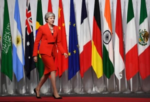The British prime minister, Theresa May, arrives for the welcoming session