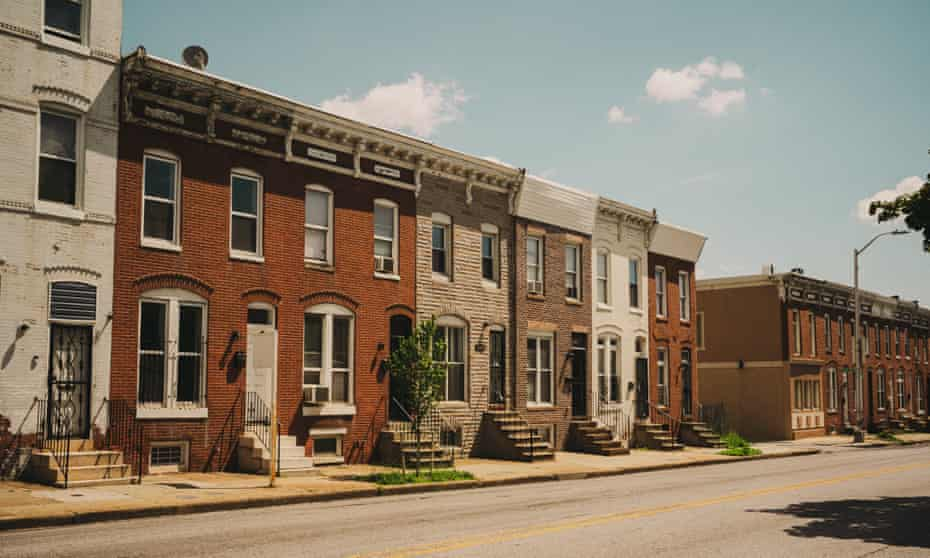 Blocks of row houses and young trees contribute to the heat issues in Baltimore.