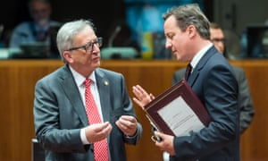 British Prime Minister David Cameron, right, speaks with European Commission President Jean-Claude Juncker during a round table meeting at an EU summit in Brussels on Thursday, June 25, 2015. EU leaders met for an EU summit to discuss, among other issues, migration and the Greek bailout. (AP Photo/Geert Vanden Wijngaert)