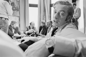 Michael Caine turns for a chat during the filming of Get Carter