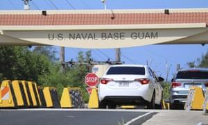 Cars enter Guam naval base.