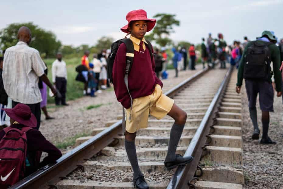 A boy waits on the tracks