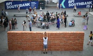 Mexican artist Bosco Sodi builds Muro, a wall on London's South Bank to protest against Donald Trump.