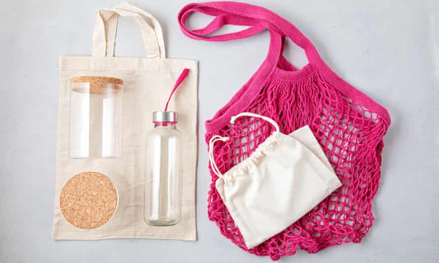 Zero waste kit. Mesh cotton bag, reusable glass containers and water bottle.