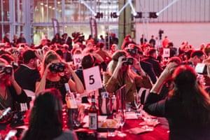 People watch a virtual reality screening at the opening night of the Adelaide film festival.