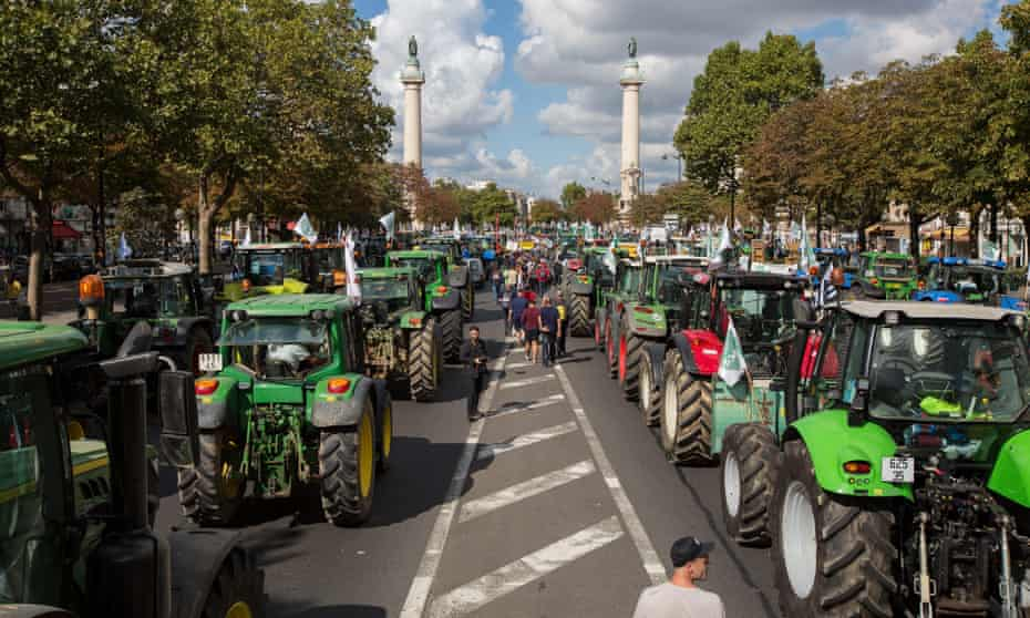 French farmers with their tractors take part in a protest at the Place de la Nation