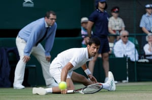 Novak Djokovic plays a shot on his way to a four-set victory over Kyle Edmund.