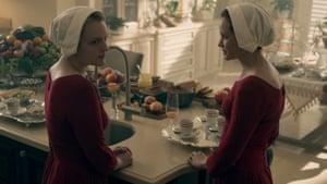 Resistance … Offred (Elisabeth Moss, left) talks to Ofglen (Alexis Bledel).