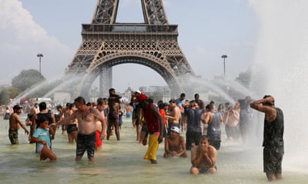 People cool off in the Trocadero fountains across from the Eiffel Tower