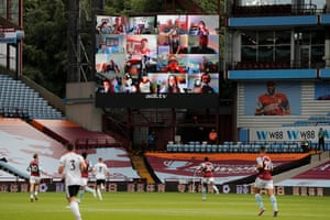 The screen showing Villa supporters watching at home.