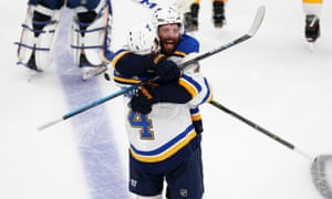 Carl Gunnarsson and Pat Maroon celebrate victory over the Bruins