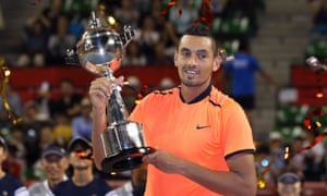 Nick Kyrgios holding a trophy
