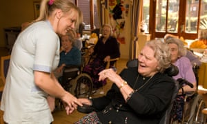 """A care worker with a resident at a care home in Isleworth, Middlesex: 'Caring will not qualify as sufficiently skilled to earn a visa, but all that brands this delicate work as """"unskilled"""" is the appalling low pay.'"""
