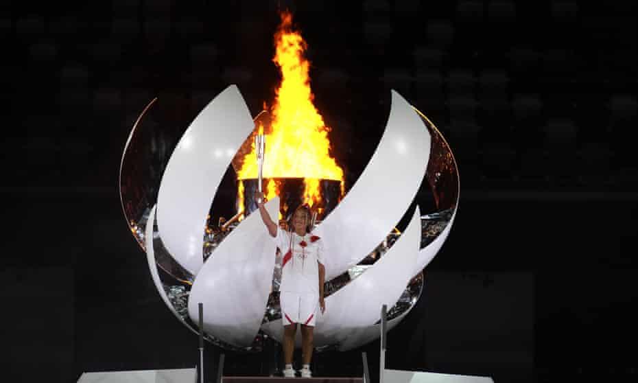 Japan's Naomi Osaka lights the cauldron