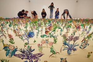 The artist Zadok Ben-David is joined by volunteers at Kew Gardens
