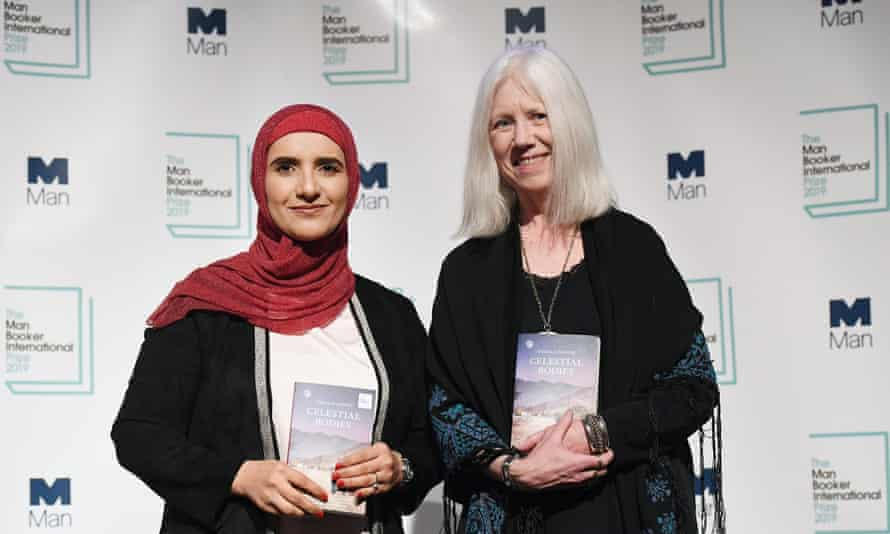 The Man Booker International Prize 2019 Previewepa07587615 Omani author Jokha al-Harthi (L) with translator Marilyn Booth (R) with Al-Harthi's book' Celestial Bodies' during a photocall for The Man Booker International Prize 2019 in London, Britain, 20 May 2019. The winner of the Man Booker International Prize 2019 will be announced in London 21 May. EPA/ANDY RAIN