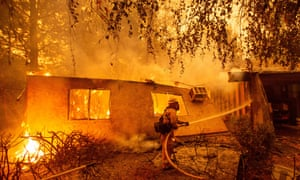Firefighters battling flames in Paradise, California, last November, as the town was engulfed by the devastating Camp fire.