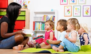 Childminder reading to a group of toddlers