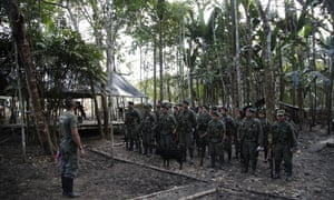 Farc rebels stand in formation in the jungle of Putumayo, Colombia