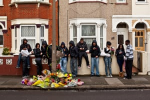 Friends of Negus McLean gather at the spot in Edmonton, north London, where the 15-year-old was stabbed to death on Sunday while trying to stop a gang stealing his brother's BlackBerry.