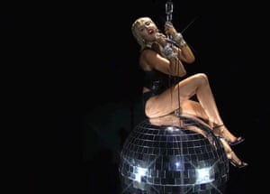 Miley Cyrus goes disco for Midnight Sky and recreates her Wrecking Ball video in the process.