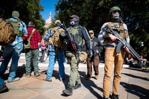 Armed groups hold a rally in front of a closed Texas State Capitol in Austin, Texas, on January 17, 2021 during a nationwide protest called by anti-government and far-right groups supporting Donald Trump and his false claims of electoral fraud.