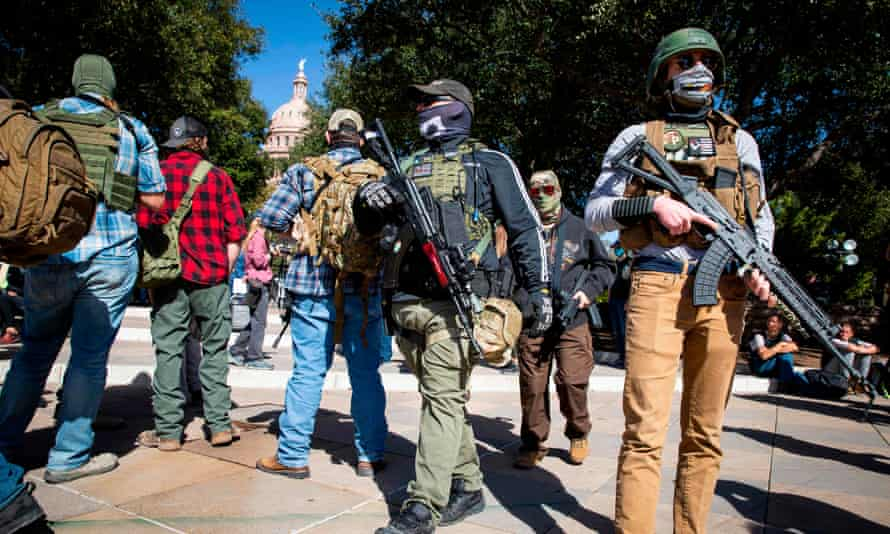 Armed groups in front of a closed Texas state capitol in Austin on 17 January during a nationwide protest of far-right groups supporting Donald Trump.