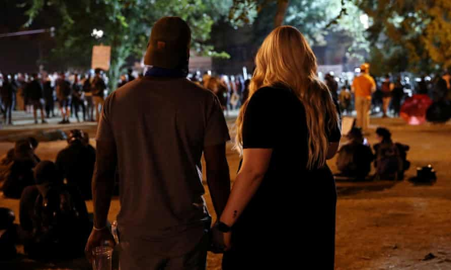 People attend a protest against racial inequality and police violence in Portland, Oregon Thursday.