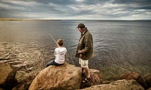 UK, Scotland, boy and senior man fishing togetherGettyImages-638527738