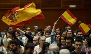 Supporters of Vox, the Spanish far-right party, wave Spanish flags.