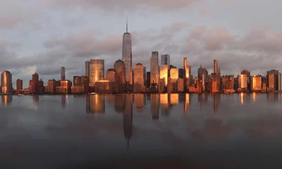 The sun sets on the skyline of lower Manhattan.