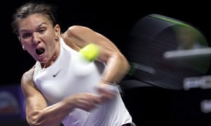 Simona Halep hits a return against Bianca Andreescu.