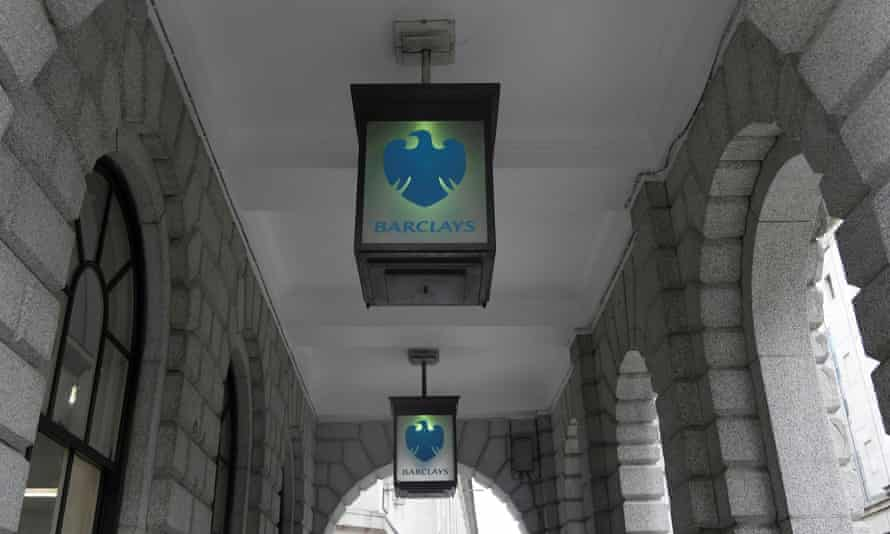 The logo of Barclays is seen on glass lamps outside a branch of the bank