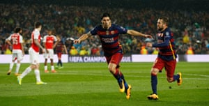 Luis Suarez celebrates after scoring the second goal for Barcelona.